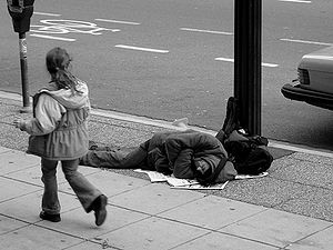 300px-man_sleeping_on_canadian_sidewalk
