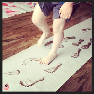 Painting with feet to make a Teacher gift