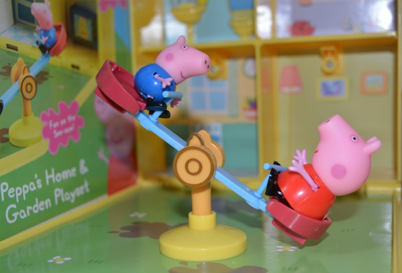 Peppa Pig and Little Brother George on the see saw