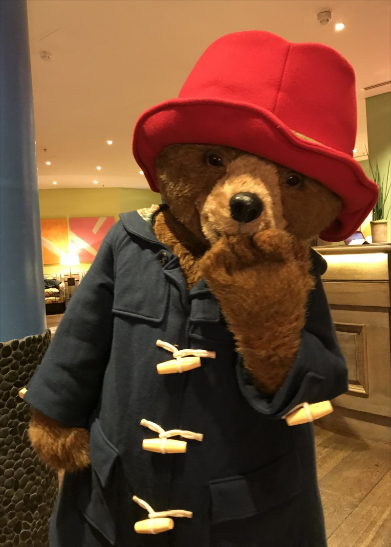 Paddington Bear in his red hat and blue duffel coat