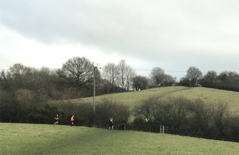 runners and a hill