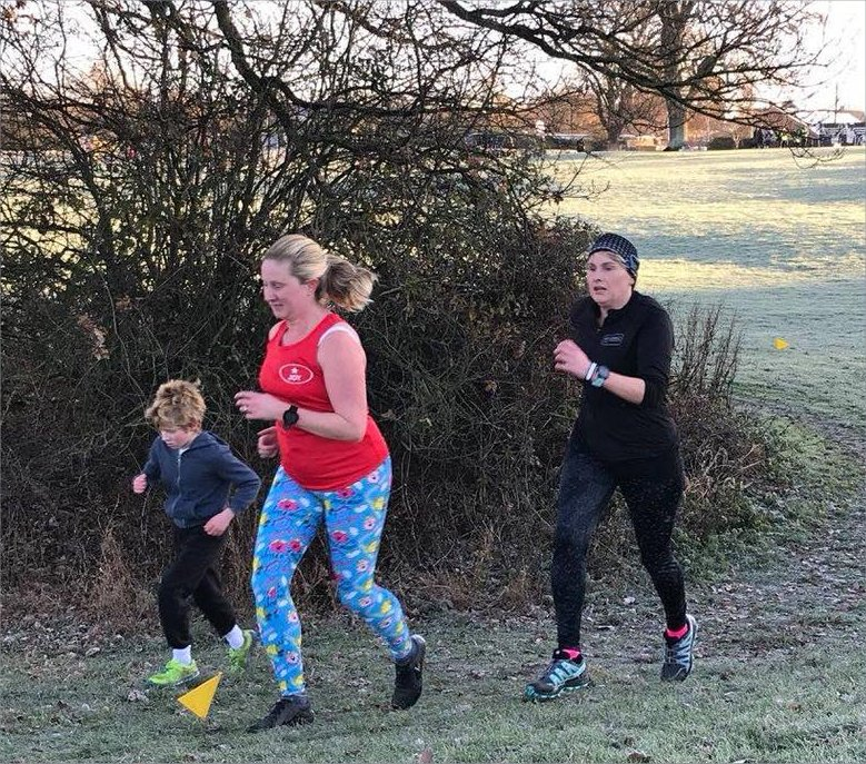 women and child running at parkrun
