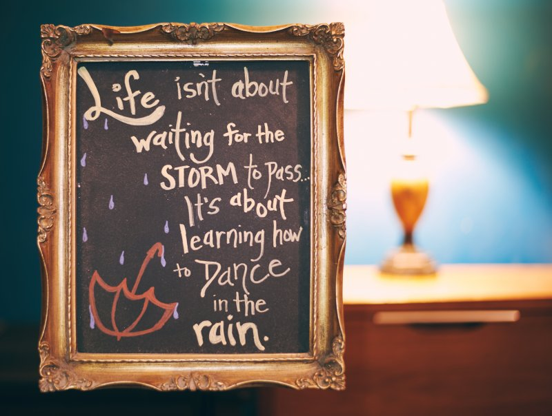 dancing in the rain quote in gold frame