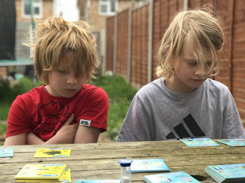 two boys concentrating
