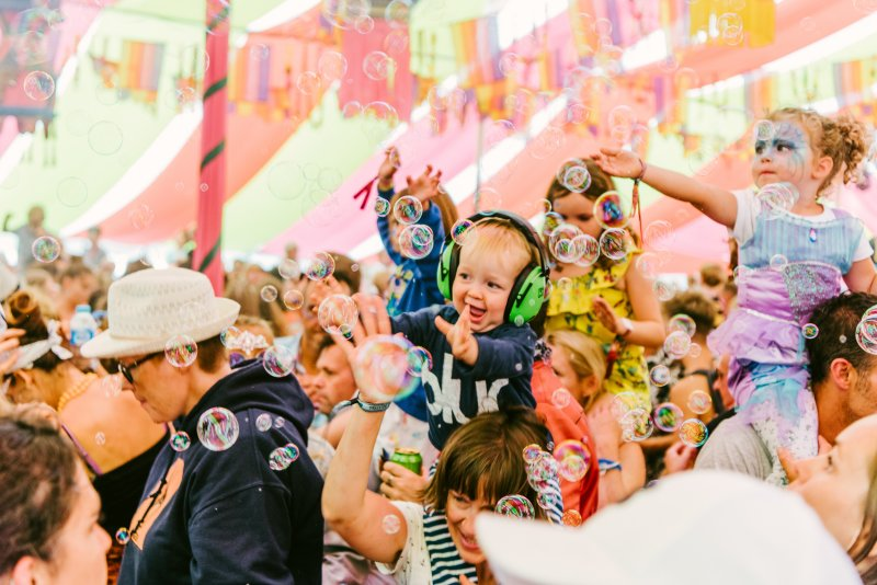 children at music festival with bubbles