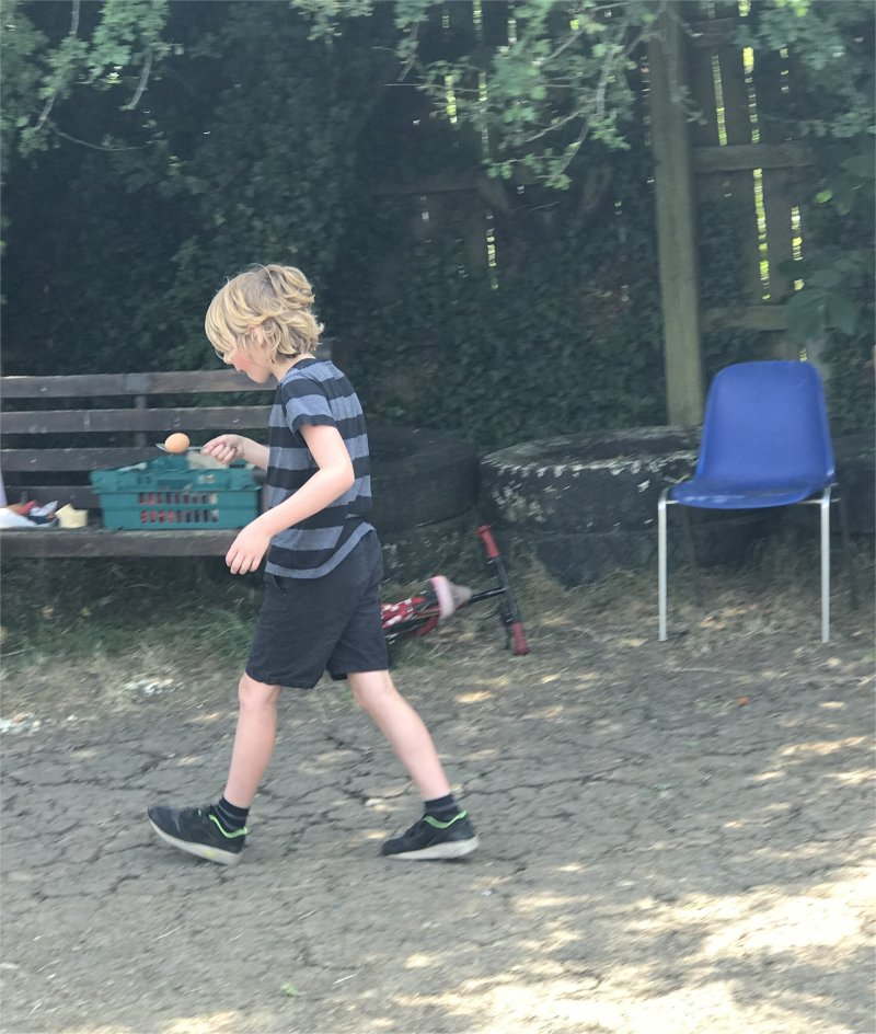 boy in egg and spoon race