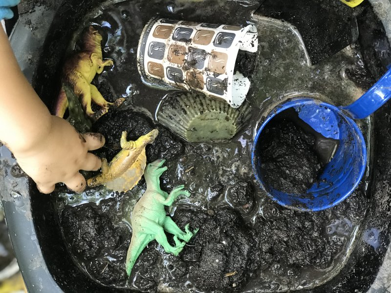 mud kitchen with dinosaurs