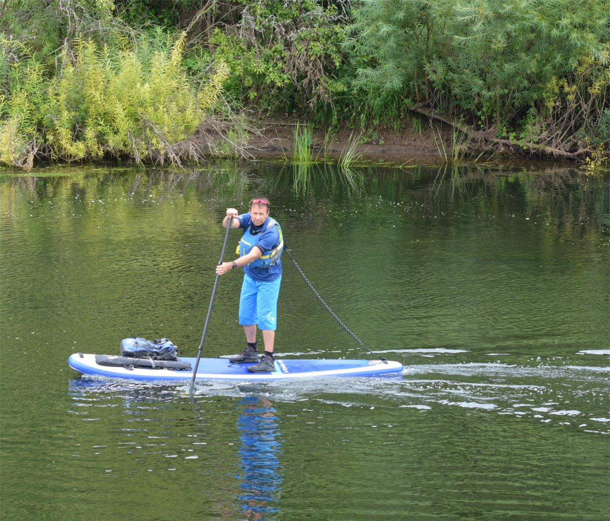 man on stand-up paddle board