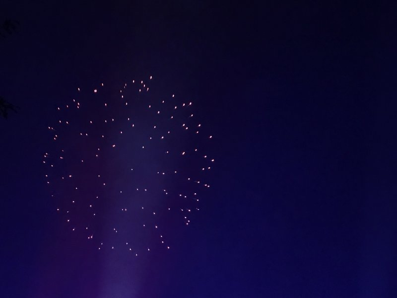 blue background and ball of fireworks at alton towers