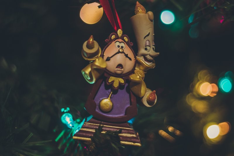cogsworth and lumiere lit up statues
