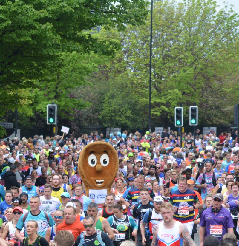 A sea of runners at London Marathon including someone dressed as a spoon