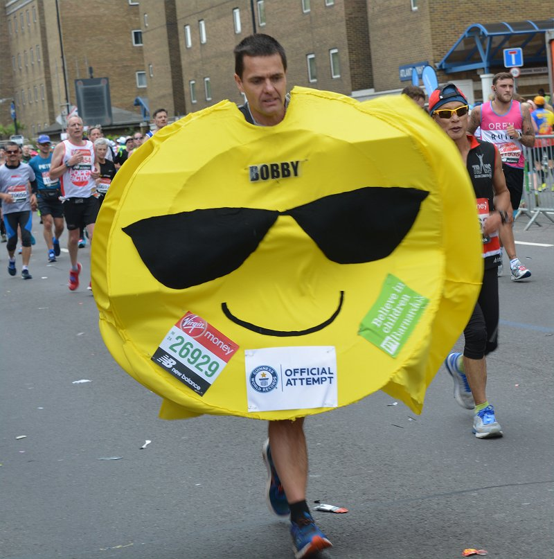London Marathon runner dressed up  as a smiley face