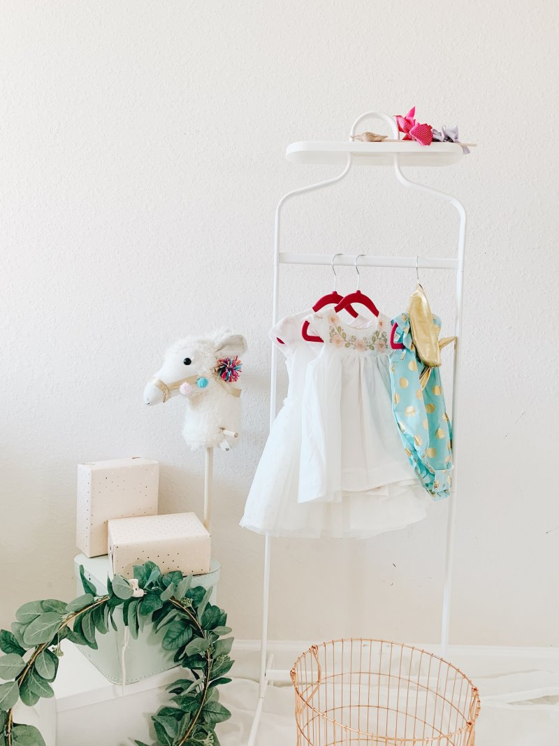 child's clothes on hanging rack