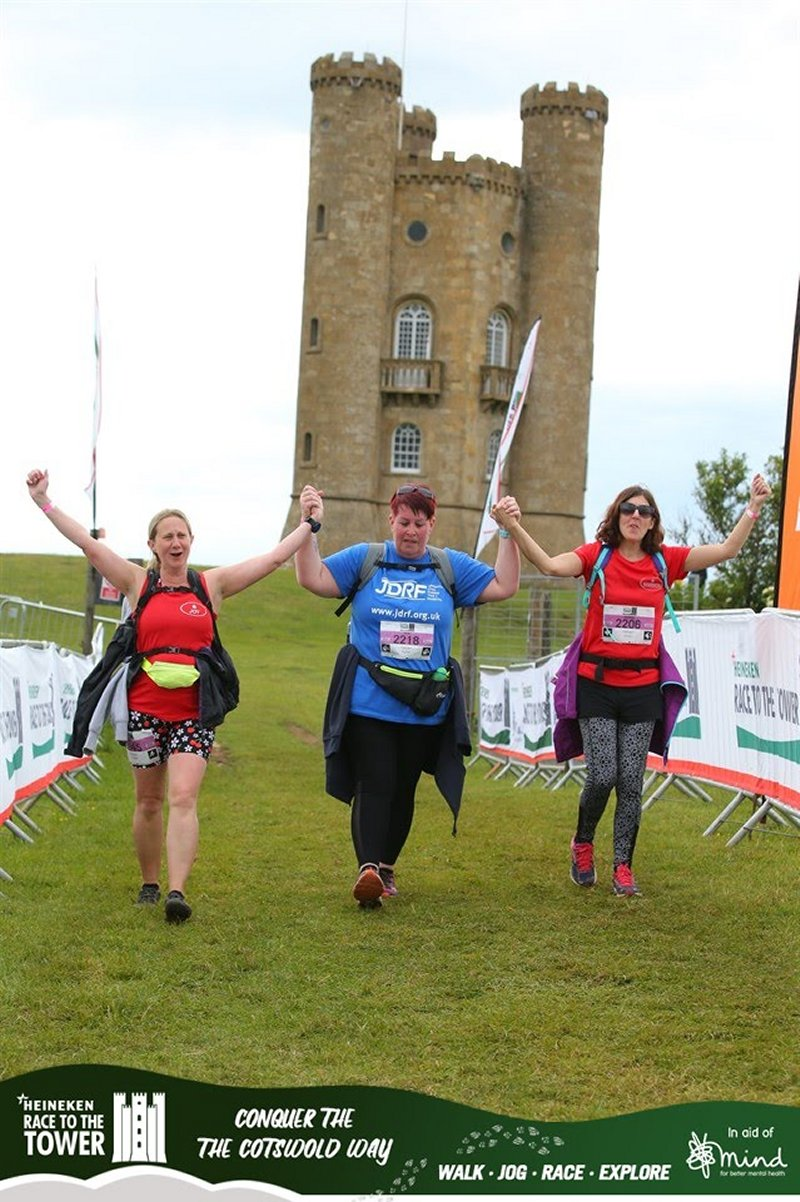 3 women finishing Race to the Tower in front of Broadway Tower